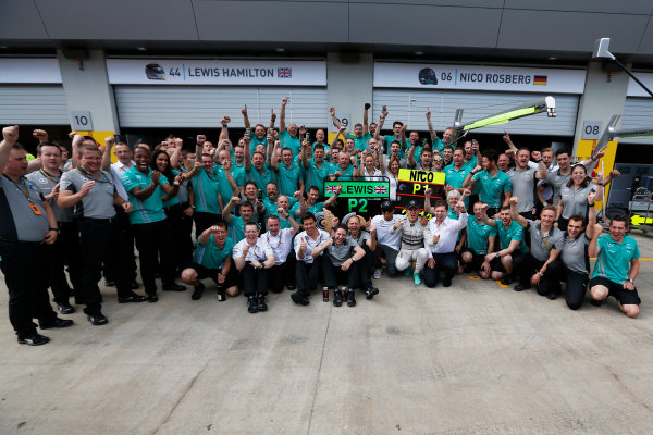 Red Bull Ring, Spielberg, Austria. Sunday 22 June 2014. Nico Rosberg, Mercedes AMG, 1st Position, and Lewis Hamilton, Mercedes AMG, 2nd Position, celebrate victory with their team. World Copyright: Sam Bloxham/LAT Photographic. ref: Digital Image _SBL0476
