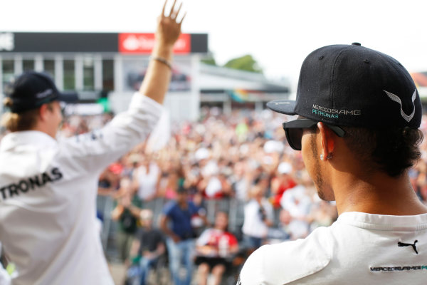 Hockenheimring, Hockenheim, Germany. Saturday 19 July 2014. Nico Rosberg, Mercedes AMG, and Lewis Hamilton, Mercedes AMG, greet the crowd. World Copyright: Charles Coates/LAT Photographic. ref: Digital Image _J5R4510