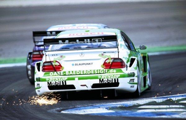 Marcel Tiemann (GER) Oase AMG Mercedes sends the sparks flying en route to a fifteenth place finish.DTM, Hockenheim, Germany, 21 April 2002.
