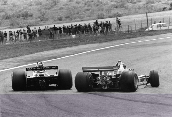 1979 Spanish Grand Prix. Jarama, Madrid, Spain. 27-29 April 1979. Gilles Villeneuve (Ferrari 312T4) 7th position, spins and is passed by Carlos Reutemann (Lotus 79-Ford) 2nd position, action. World Copyright - LAT Photographic. ref: 12413/13.