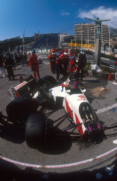 1991 Monaco Grand Prix.Monte Carlo, Monaco.26-28 April 1991.Alex Caffi's destroyed Footwork FA12 Porsche behind the barriers at the Swimming Pool Complex after his crash there during Saturday's free practice. He failed to qualify.Ref-91 MON 07.World Copyright - LAT Photographic