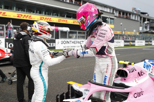 Esteban Ocon, Racing Point Force India, celebrates qualifying in third place with colleagues, with pole McLaren sitter Lewis Hamilton, Mercedes AMG F1.