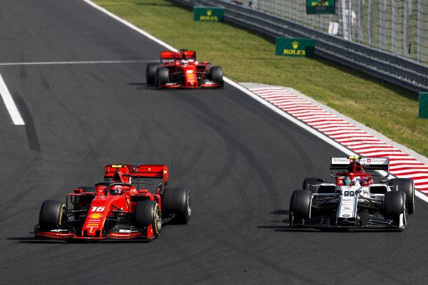 Charles Leclerc, Ferrari SF90, puts a lap on Antonio Giovinazzi, Alfa Romeo Racing C38, ahead of Sebastian Vettel, Ferrari SF90