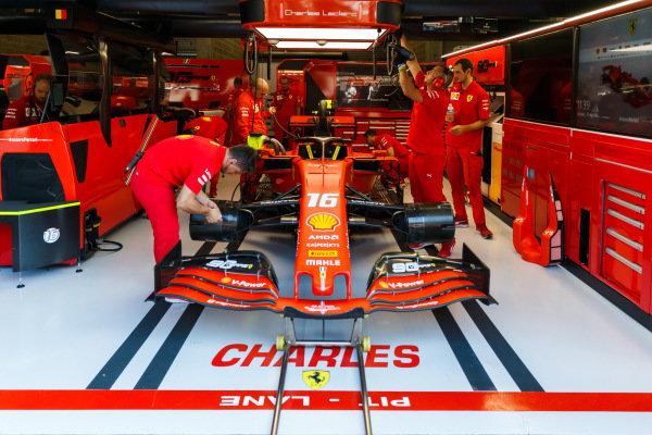 Mechanics work on the car of Charles Leclerc, Ferrari SF90