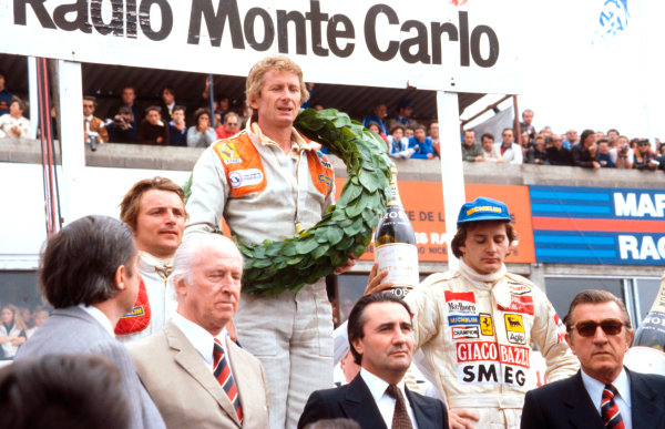 1979 French Grand Prix.Dijon-Prenois, France.29/6-1/7 1979.Jean-Pierre Jabouille (Equipe Renault) 1st position, Gilles Villeneuve (Ferrari) 2nd position and Rene Arnoux (Equipe Renault) 3rd position on the podium. FIA President Jean-Marie Balestre stands in front on the right.Ref-79 FRA 03.World Copyright - LAT Photographic