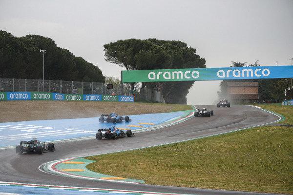 Fernando Alonso, Alpine A521, runs wide ahead of Esteban Ocon, Alpine A521, and Sebastian Vettel, Aston Martin AMR21