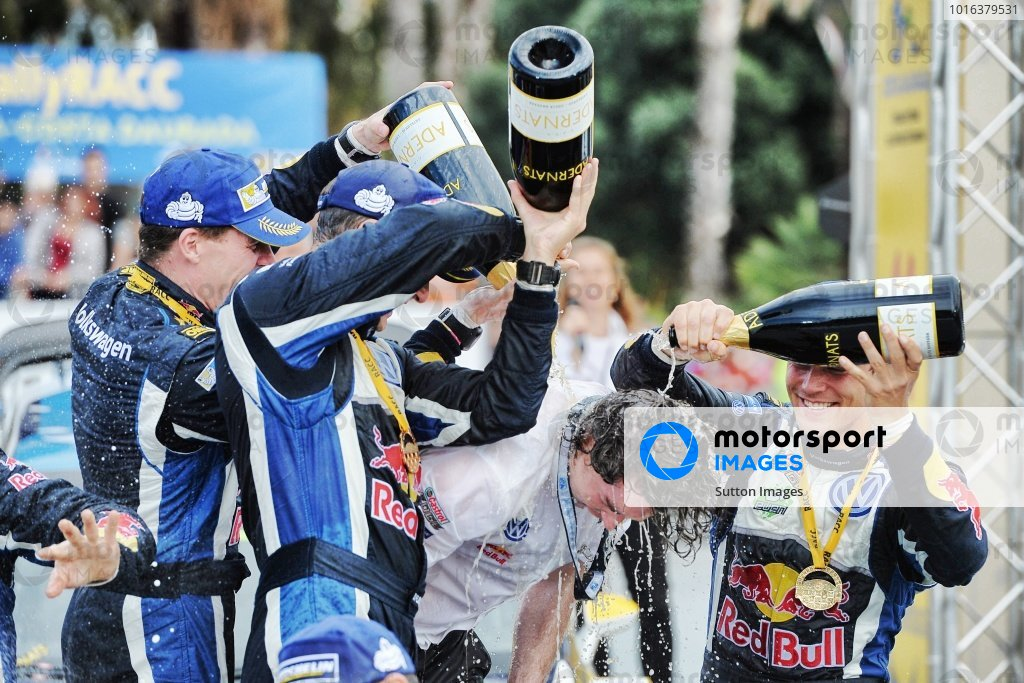 Race winner Andreas Mikkelsen (NOR) / Ola Floene (NOR) Volkswagen Polo R WRC celebrate with champagne on the podium at FIA World Rally Championship, Rd12, RAAC Rally de Espana, Day Three, Costa Daurada, Catalunya, Spain, 25 October 2015.