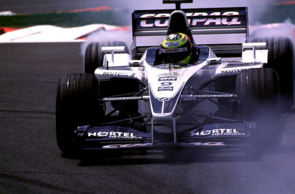 French Grand Prix.Magny-Cours, France. 30/6-2/7 2000.Ralf Schumacher (Williams FW22 BMW) smokes up his rear tyres, as he recovers from a spin.World Copyright - LAT PhotographicFormat: 35mm transparency