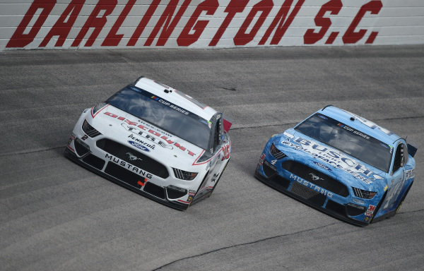 Brad Keselowski, Team Penske Ford Discount Tire, leads Kevin Harvick, Stewart-Haas Racing Ford Busch Light YOURFACEHERE Copyright: Jared C. Tilton/Getty Images.