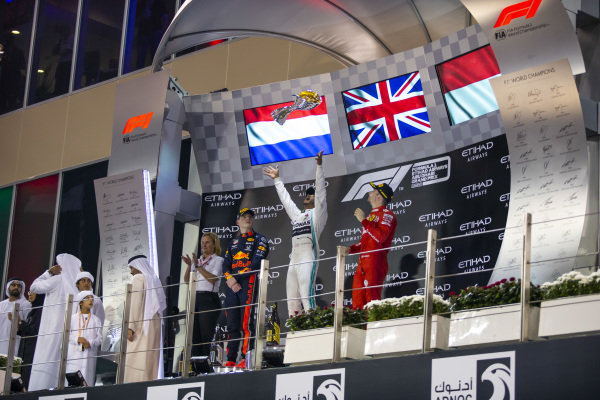Max Verstappen, Red Bull Racing, 2nd position, Lewis Hamilton, Mercedes AMG F1, 1st position, and Charles Leclerc, Ferrari, 3rd position, on the podium