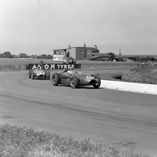 Carroll Shelby, Aston Martin DBR4/250, leads David Piper, Lotus 16 Climax.