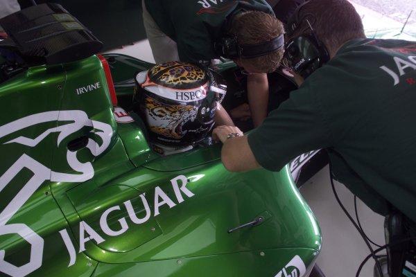 2000 German Grand Prix.Hockenheim, Germany.28-30 July 2000.Eddie Irvine (Jaguar) prepares for practice.World Copyright - Coates/LAT Photographicref: 5mb digital Race