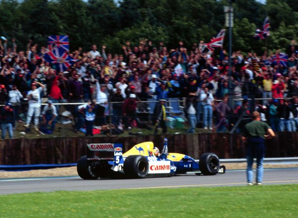 1992 British Grand Prix.Silverstone, England.10-12 July 1992.Nigel Mansell (Williams FW14B Renault) 1st position. World Copyright - LAT Photographic