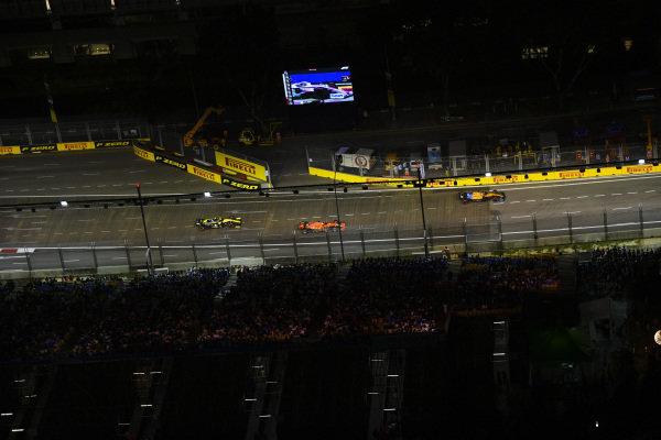 Carlos Sainz Jr., McLaren MCL34, Sebastian Vettel, Ferrari SF90 and Nico Hulkenberg, Renault R.S. 19