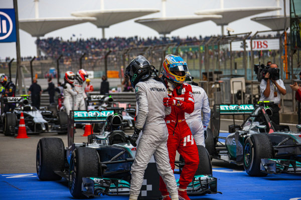 Nico Rosberg and Fernando Alonso embrace in Parc Ferme.