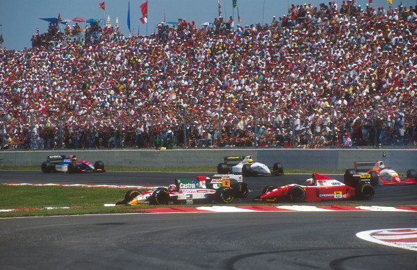 1993 French Grand Prix.Magny-Cours, France.2-4 July 1993.Johnny Herbert (Lotus 107B Ford) battles with Derek Warwick (Footwork FA14 Mugen-Honda) and Gerhard Berger (Ferrari F93A) at the Adelaide Hairpin.Ref-93 FRA 06.World Copyright - LAT Photographic