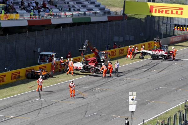 Cars of Carlos Sainz, McLaren MCL35, Kevin Magnussen, Haas VF-20 and Antonio Giovinazzi, Alfa Romeo Racing C39 being recovered after crashing