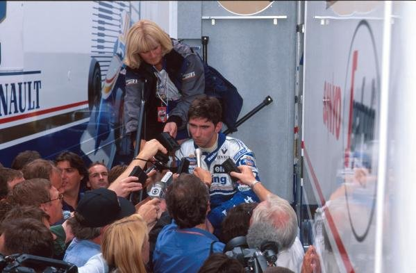 Damon Hill is captured by the worlds media after spinning out on lap 2.