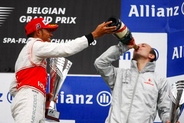Spa-Francorchamps, Spa, Belgium 29th August 2010 Lewis Hamilton, McLaren MP4-25 Mercedes, 1st position, celebrates with Phil Prew, Race Engineer, McLaren. Portrait. Podium.  World Copyright: Charles Coates/LAT Photographic ref: Digital Image _26Y6861