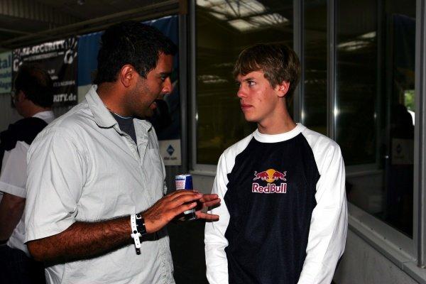 (L to R): PJ Rashidi (USA) Alpine Stars F1 Co-Ordinator talks with Sebastian Vettel (GER). Red Bull Hockenheim Petit Prix, Mannheim, Germany, 23 July 2005. DIGITAL IMAGE