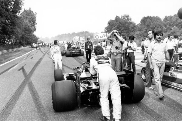 1978 Italian Grand Prix.Monza, Italy. 10 September 1978.Mario Andretti (Lotus 79-Ford Cosworth) waits on the grid as the aftermath of the first lap accident is cleared. Team mate Ronnie Peterson suffered fatal injuries in the crash.World Copyright: LAT PhotographicRef: Black & print