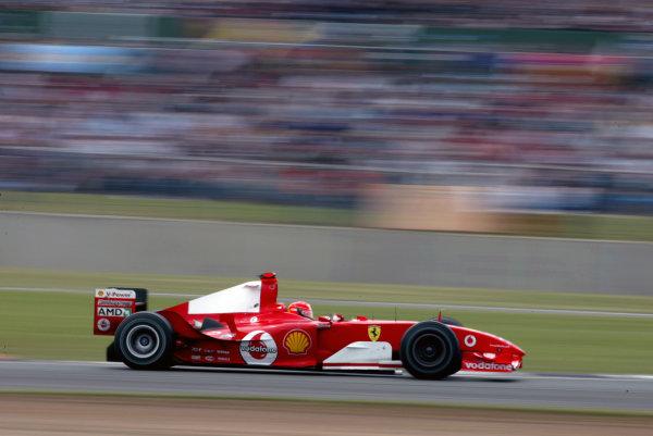 2004 British Grand Prix - Sunday Race,Silverstone, Britain. 11th July 2004 Race winner Michael Schumacher, Ferrari F2004, action.World Copyright: Steve Etherington/LAT Photographic ref: Digital Image Only