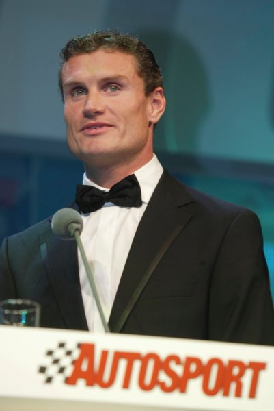2003 AUTOSPORT AWARDS, The Grosvenor, London. 7th December 2003.David Coulthard receives a Gold award from the BRDC.Photo: Peter Spinney/LAT PhotographicRef: Digital Image only