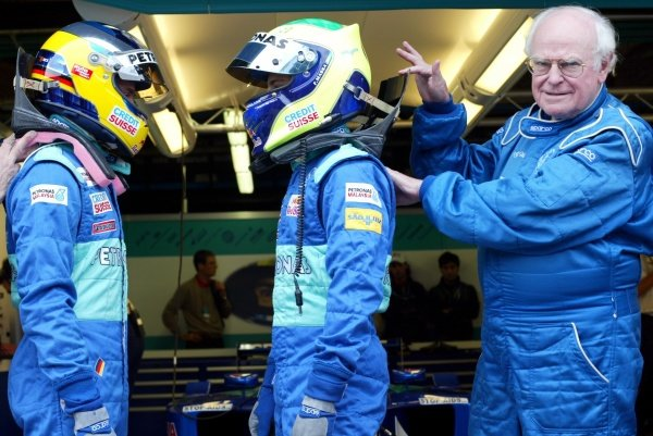 (L to R): Sauber drivers Nick Heidfeld (GER) and Felipe Massa's (BRA) are using HANS devices in a race meeting for the first time, as approved by FIA Doctor Sid Watkins (GBR).  Italian Grand Prix, Monza, 13 September 2002. DIGITAL IMAGE