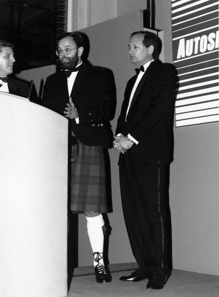 1989 Autosport Awards. Cafe Royal, London, England. 4th January 1990. Steve Rider, Peter Foubister and Ron Dennis prepare to present David Coulthard with the 1989 McLaren Autosport Young Driver of the Year, portrait. World Copyright: LAT Photographic. Ref: B/W Print.