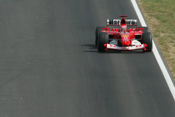 2003 Hungarian Grand Prix - Friday Qaulifying, Budapest, Hungary.22nd August 2003.Michael Schumacher, Ferrari F2003 GA, action.World Copyright LAT Photographic.Digital Image Only.