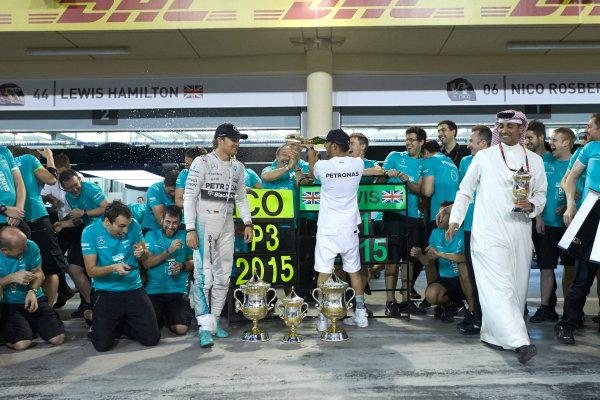 Bahrain International Circuit, Sakhir, Bahrain. Sunday 19 April 2015. Lewis Hamilton, Mercedes AMG, 1st Position, Nico Rosberg, Mercedes AMG, 3rd Position, and the Mercedes team celebrate victory. World Copyright: Steve Etherington/LAT Photographic. ref: Digital Image SNE24529
