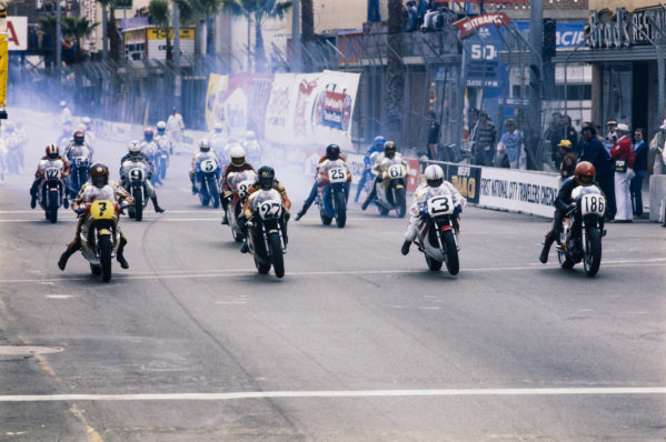Barry Sheene, Suzuki, Skip Aksland, Yamaha, Gene Romero, Yamaha, and Mike Baldwin, Yamaha, lead the riders away at the start.