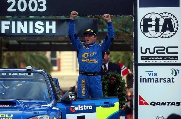 (L to R): Rally winner Petter Solberg (NOR) Subaru celebrates victory on the podium.