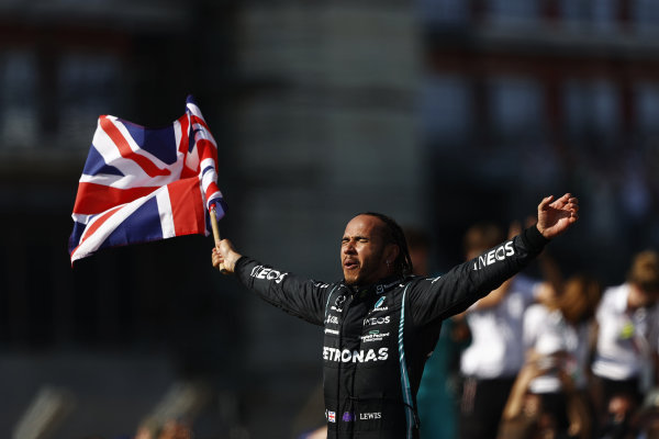 Sir Lewis Hamilton, Mercedes, 1st position, celebrates after the race whilst parading the Union flag