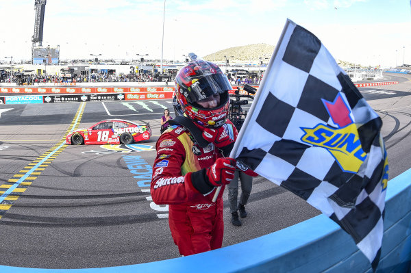 #18: Kyle Busch, Joe Gibbs Racing, Toyota Camry SKITTLES, celebrates after winning theTicketGuardian 500 in Phoenix.
