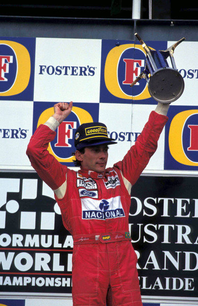 Ayrton Senna, 1st position, on the podium.