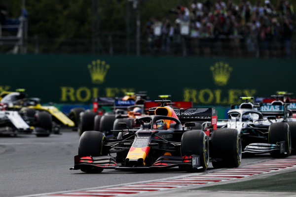 MvMax Verstappen, Red Bull Racing RB15 leads Valtteri Bottas, Mercedes AMG W10 at the start of the race
