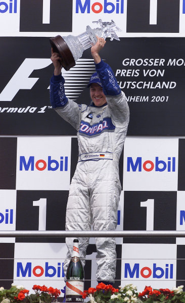 2001 German Grand Prix - Race.Hockenheim, Germany. 29th July 2001.Race winner Ralf Schumacher, BMW Williams FW23, podium.World Copyright: Steve Etherington/LAT Photographic.ref: 17 5mb Digital Image