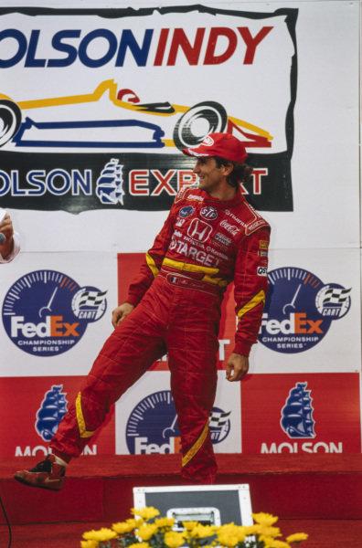 Alex Zanardi, 1st position, on the podium.