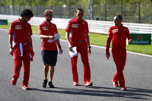 Sebastian Vettel, Ferrari, walks the circuit with colleagues.