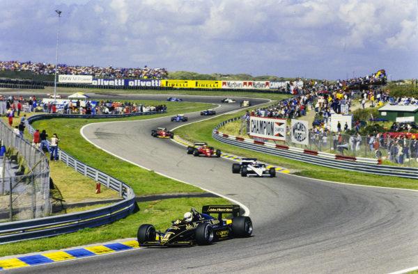 Elio de Angelis, Lotus 97T Renault, leads Marc Surer, Brabham BT54 BMW, Stefan Johansson, Ferrari 156/85, and Michele Alboreto, Ferrari 156/85.