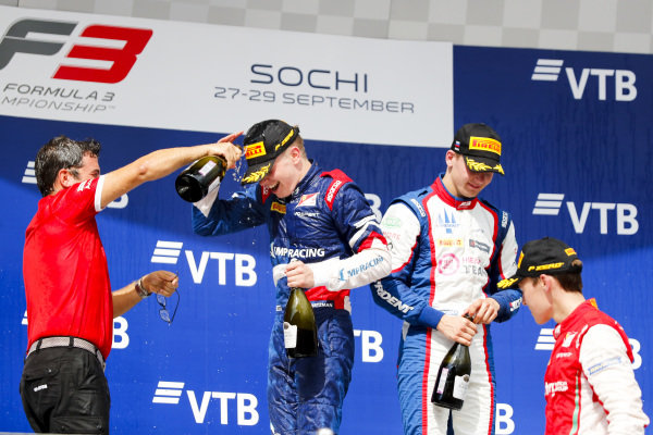 SOCHI AUTODROM, RUSSIAN FEDERATION - SEPTEMBER 28: Robert Shwartzman (RUS, PREMA Racing), Marcus Armstrong (NZL, PREMA Racing) and Niko Kari (FIN, Trident) on the podium with the champagne during the Sochi at Sochi Autodrom on September 28, 2019 in Sochi Autodrom, Russian Federation. (Photo by Carl Bingham / LAT Images / FIA F3 Championship)