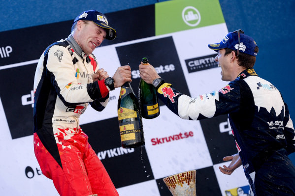 Rally winner Jari-Matti Latvala (FIN), Toyota Gazoo Racing WRC and third placed Sebastien Ogier (FRA), M-Sport World Rally Team WRC celebrate on the podium with the chmpagne at World Rally Championship, Rd2, Rally Sweden, Day Three, Karlstad, Sweden, 12 February 2017.