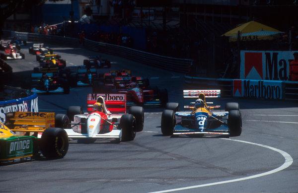 1993 Monaco Grand Prix.Monte Carlo, Monaco.20-23 May 1993.Ayrton Senna (McLaren MP4/8 Ford) passes Damon Hill (Williams FW15C Renault) on the inside into Ste. Devote at the start.Ref-93 MON 09.World Copyright - LAT Photographic
