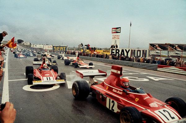 Jarama, Madrid, Spain. 26 - 28 April 1974.Niki Lauda (Ferrari 312B3), 1st position, leads Clay Regazzoni (Ferrari 312B3), 2nd position and Emerson Fittipaldi (McLaren M23) 3rd position, at the start of the race, action. World Copyright: LAT Photographic.Ref:  74ESP