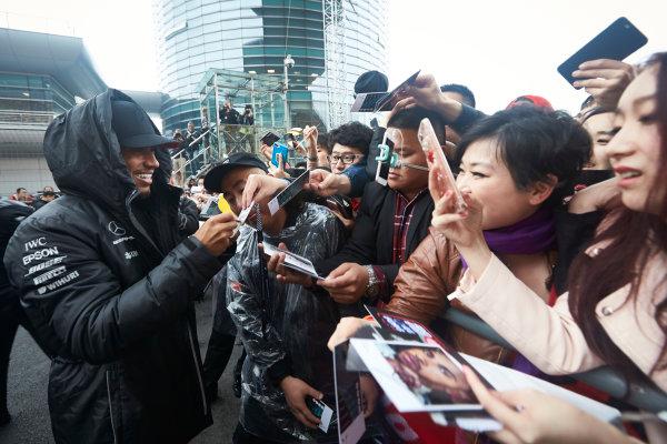 Shanghai International Circuit, Shanghai, China.  Thursday 6 April 2017. Lewis Hamilton, Mercedes AMG, signs autographs for fans. World Copyright: Steve Etherington/LAT Images ref: Digital Image SNE15975