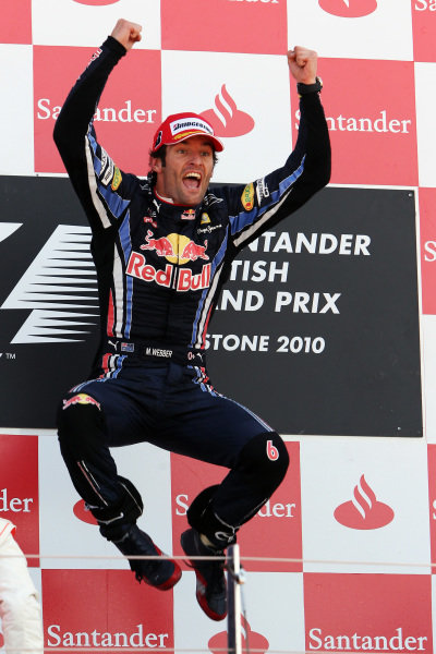 Race winner Mark Webber (AUS) Red Bull Racing celebrates on the podium. Formula One World Championship, Rd 10, British Grand Prix, Race, Silverstone, England, Sunday 11 July 2010.  BEST IMAGE