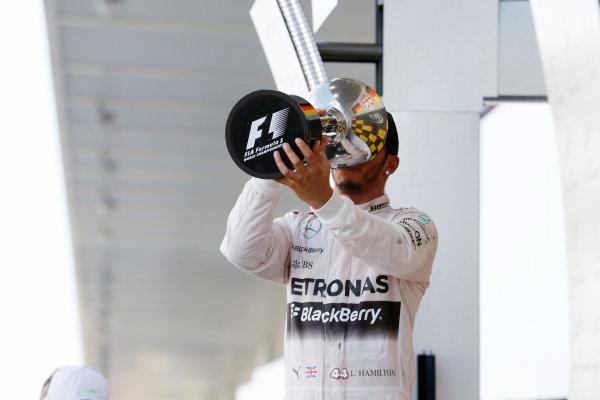 Suzuka Circuit, Suzuka, Japan. Sunday 27 September 2015. Lewis Hamilton, Mercedes AMG drinks from his trophy. World Copyright: Steven Tee/LAT Photographic. ref: Digital Image _X0W2061