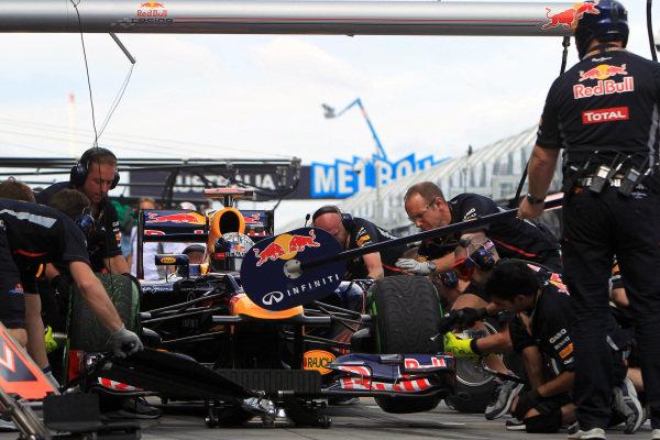 Sebastian Vettel (GER) Red Bull Racing RB8 makes a pit stop. Formula One World Championship, Rd1, Australian Grand Prix, Practice, Albert Park, Melbourne, Australia, Friday 16 March 2012.
