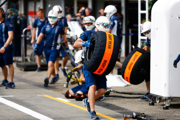 Hockenheim, Germany. Thursday 28 July 2016. Williams team members carry tyre in blankets on the pit lane. World Copyright: Andy Hone/LAT Photographic ref: Digital Image _ONZ4801
